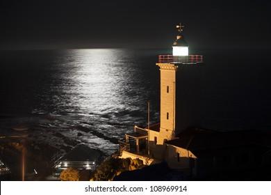 'Lighthouse shining over ocean'
