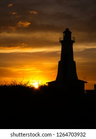 Lighthouse Silhouette against a beautiful sunset