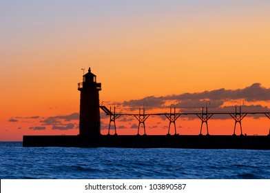 Lighthouse silhouette. Image of a lighthouse silhouette at sunset.