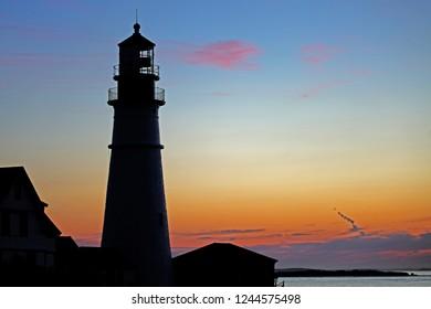 Lighthouse silhouette sunrise