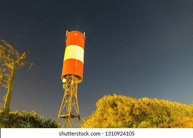 Lighthouse at starry night.