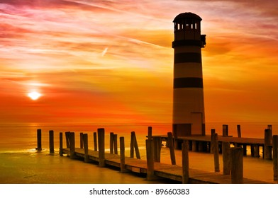 Lighthouse at the sunset on the frozen lake