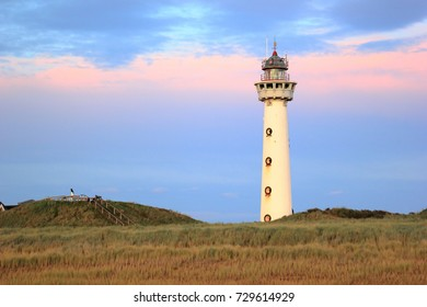 Lighthouse at sunset in the twilight. Egmond aan Zee, North Sea, the Netherlands.