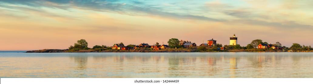 Lighthouse in Swedish archipelago during sunset - Panorama