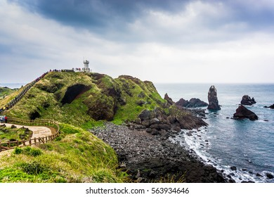 Lighthouse, the target of treking in Seopjikoji. Located at the end of the Eastern shore of Jeju island, South Korea