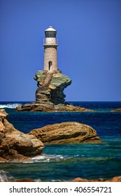 Lighthouse Tourlitis on a single rock, in Chora, Andros island, Cyclades, Greece