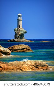 Lighthouse Tourlitis standing on a single rock, in Chora, Andros island, Cyclades, Greece