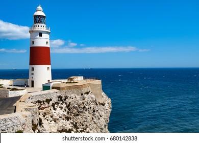 Lighthouse Trinity High on Europe Point. On a sunny summer day, a deep blue sky. skyline. Atlantic ocean