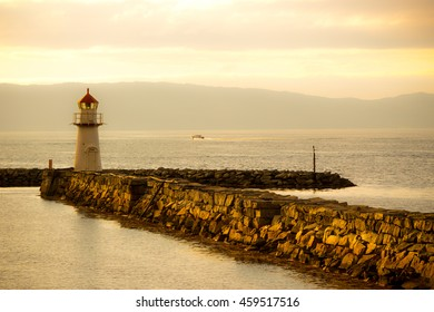 Lighthouse at Trondheim just before sunset