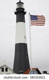 Lighthouse with US Flag flying, Tybee Island, GA