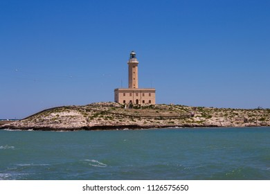 The Lighthouse of Vieste, rises on the rock of Santa Eufemia and or of S. Eugenia (located between the rocks Santa Croce and San Francesco), just in front of the town of Vieste.