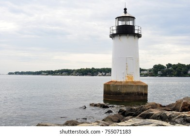 Lighthouse in the water on ocean sea shore