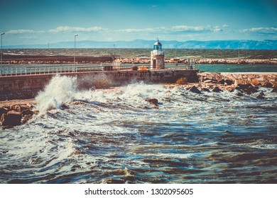 Lighthouse and waves on Adriatic sae in city of Trani, region Puglia, Italy
