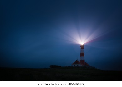 Lighthouse Westerheversand at the North Sea of Germany