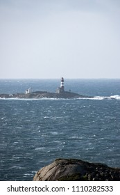 Lighthouse in winter storm ocean