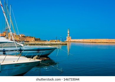 Lighthouse and yachts in Chania on island of Crete, Greece