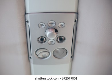 Lighting and air conditioning vent in bus. White color. Control on top of the seat in international bus close up