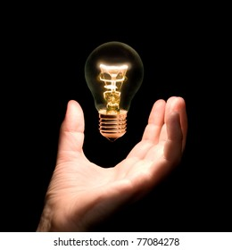 lighting bulb lamp over hand - symbolizing inviting new idea