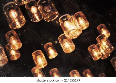 Lighting bulbs in glass jar decoration of Christmas market booth