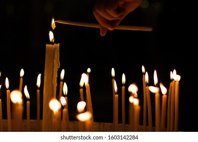 Lighting up a candle in an Eastern Orthodox Church