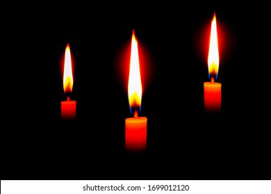 The lighting candles, Burning candle on black background, Candlelit in the dark, Candle flame at night. Lighting design for the background. Candle in the dark, Design for the background.