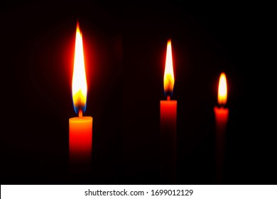 lighting candles, Burning candle on black background, Candle in hand, Candle in the dark, Design for the background.