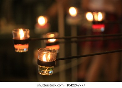 Lighting candles in the glass.
