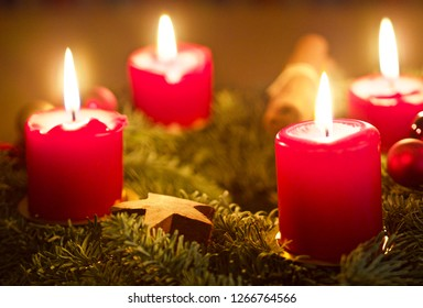 lighting candles on an advent wreath
