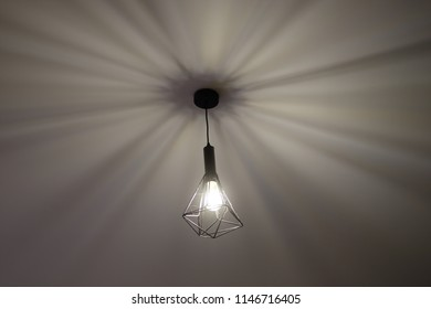 Lighting from the ceiling lamp. Causes shadow on the ceiling.