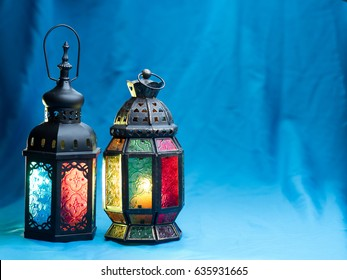 lighting with colors  on muslim style's lantern shining on cyan fabric background