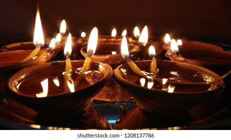 It is a lighting Deepak (a lamp of oil ) introduce in the homes in India during Diwali.Its a symbol of happiness and joy.