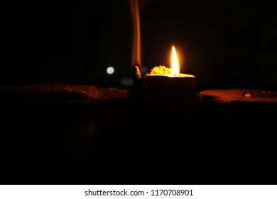 Lighting deepak under the dark sky