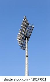 lighting equipment, mounted on a pole. location - the stadium, blue sky