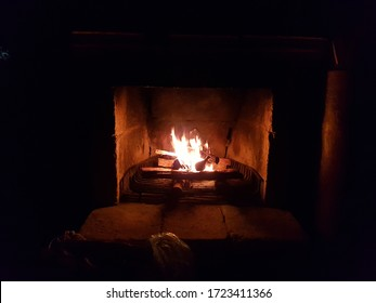 Lighting the fire in the cabin chimney using logs, Mexico