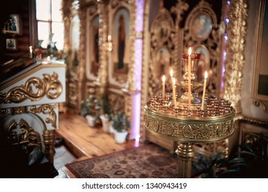 lighting fire candles in russian orthodox church