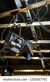 lighting fixtures in a television studio attached to the ceiling