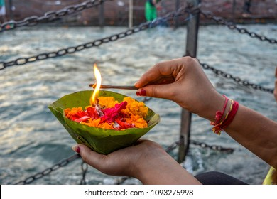 Lighting up flower basket at ganga ghat