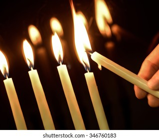 Lighting Menoral Candles on Black