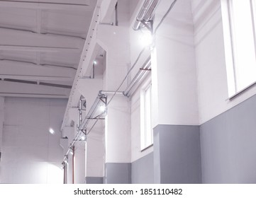 Lighting with modern LED floodlights in the production room for storing raw materials. Indoors