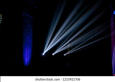 lighting in a nightclub / bar / restaurant. spotlights in a nightclub. Geometrical white concert lights on bright stage lights with white Laser rays shining in different directions