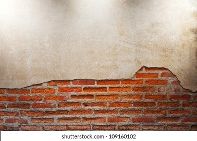 lighting on old grunge brick wall with space for text