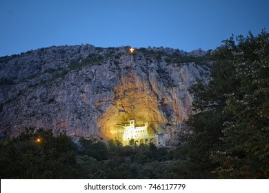 lighting Ostrog Monastery on rocky wall at twilight, Montenegro