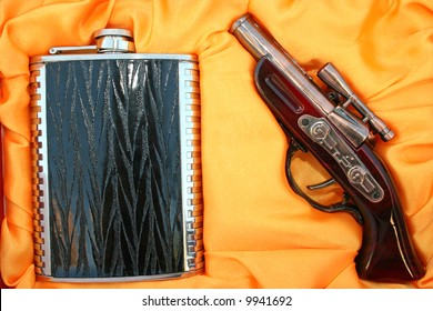 Lighting pistol and flask as a nice present set for men.