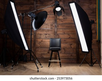 Lighting set up in photostudio with wooden background