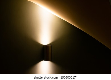 Lighting in stairwell with curved walls and ceiling