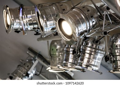 Lighting system. Spotlights and ceiling lights. Plant engineering within a commercial activity. Shop interior.