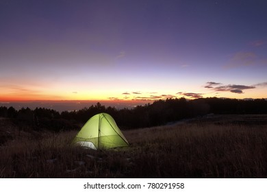 lighting tent at the sunset from Galvarina highland in Etna Park, Sicily