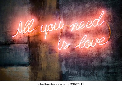 lighting words on a concrete wall, all you need is love. Valentine's day