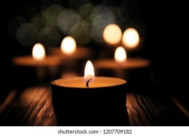 lightining candles on dark background