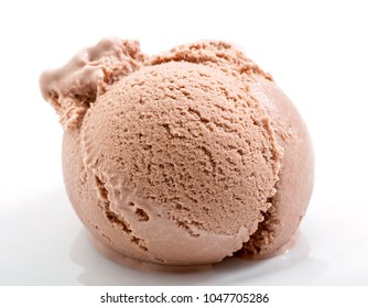 lightly melted chocolate ice cream scoop on white plate close-up